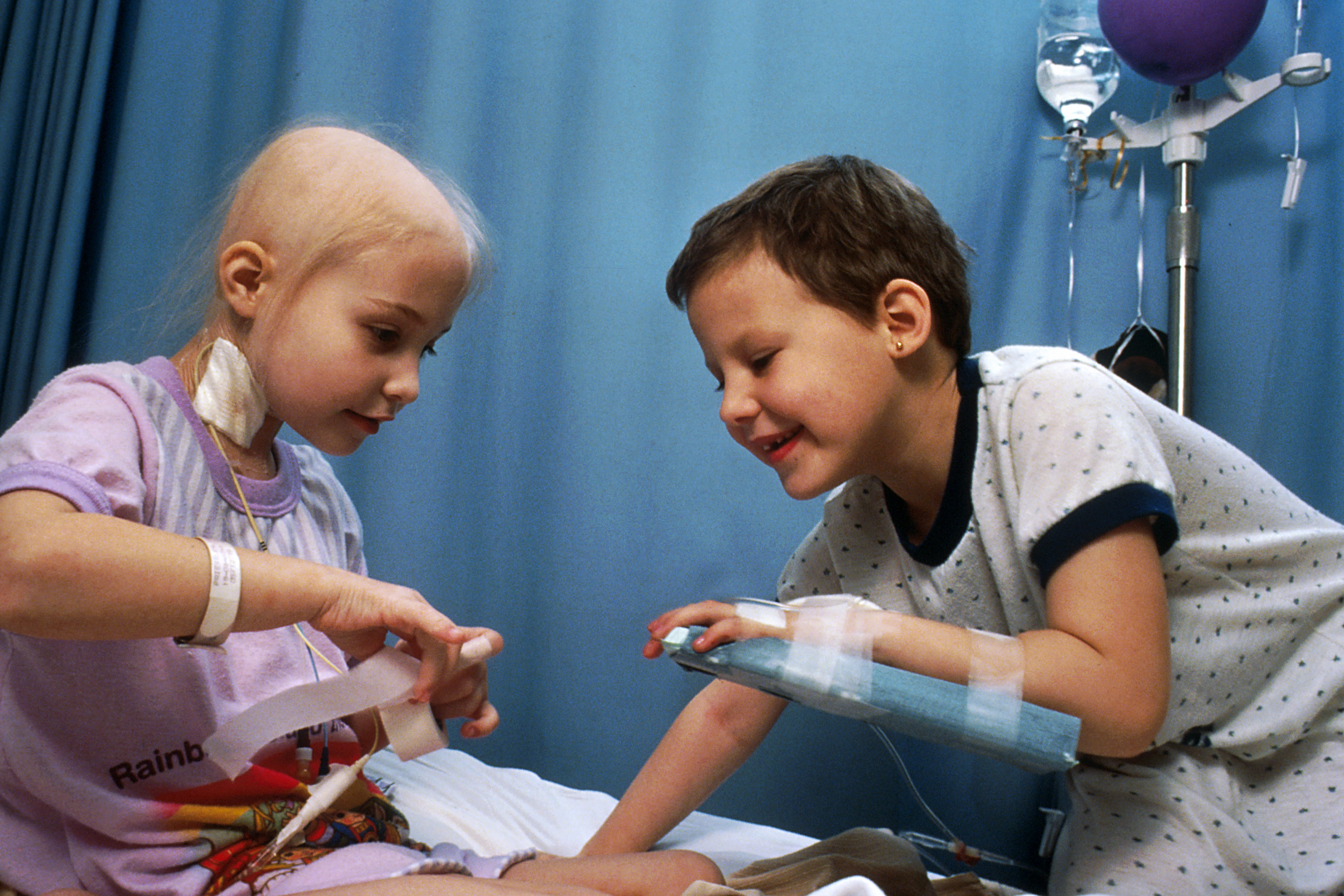 Two acute lymphocytic leukemia patients who are receiving chemotherapy; they are demonstrating some of the procedures used with chemotherapy
