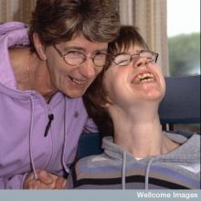 Mother and her daughter with cerebral palsy
